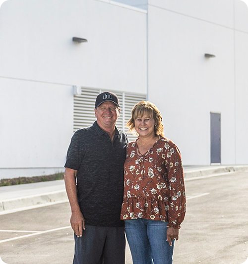 Darren and Julie outside Accurate Self Storage main entrance