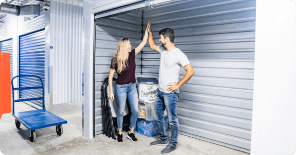 Aqueela and Ryan celebrate getting a small self storage unit at Accurate Self Storage