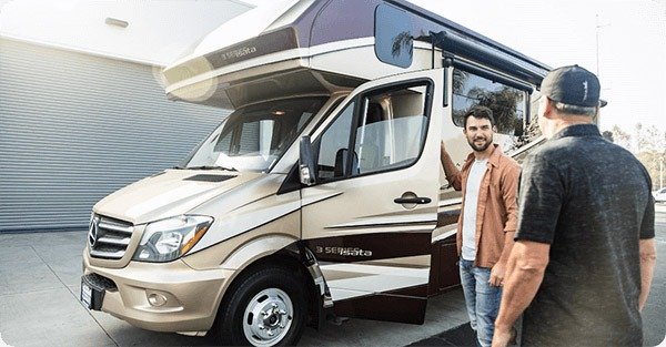 Ryan talking with Darren about his RV drop off at Accurate Self Storage